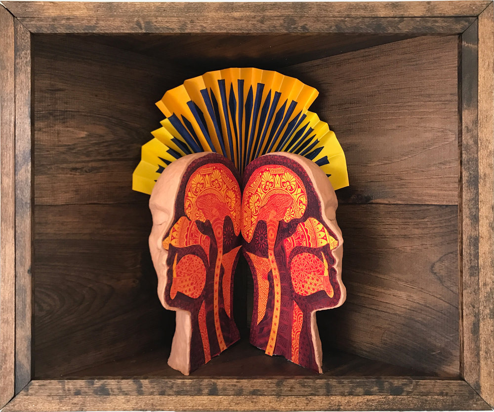 Ornamented Head   Screen print on paper, acrylic paint, and polymer clay in wooden shadow box 18.5 x 24 x 12 inches